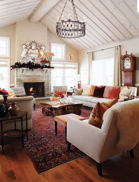 """A neutral palette is warmed by a richly coloured rug and throw pillows."""