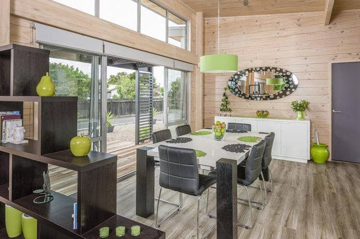 Lockwood Takanini show home with high clerestory windows, blonded timber and pops of green with black, charcoal and white.