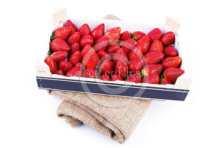 Wholesale strawberries in wooden box ready to be delivered.