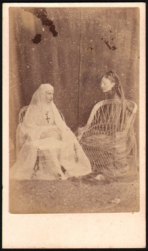 Anonymous - c1870s spirit photograph of two ghostly figures, one of which is a young nun.