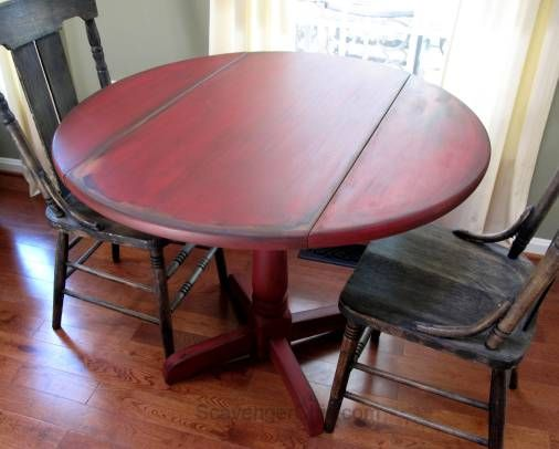 See the paint technique she used to get the black edges - red painted drop leaf table from Scavenger Chic