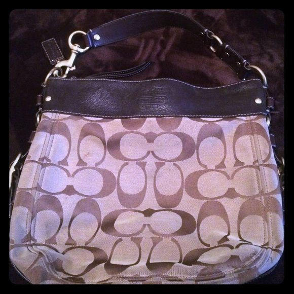Good condition coach purse (real) Def stains on front, bottom, sides, and back of purse. All can be treated and removed  The interior is light purple silk with some ink stains on the inside. It's truly a great purse, just got a Michael kors purse so I don't use this beautiful purse anymore. Please no low ballers!! Coach Bags Shoulder Bags