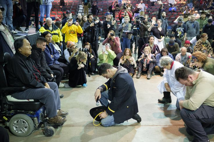 Forgiveness Ceremony Unites Veterans And Natives At Standing Rock Casino.   Wesley Clark Jr., middle, and other veterans kneel in front of Leonard Crow Dog during a forgiveness ceremony at the Four Prairie Knights Casino & Resort on the Standing Rock Sioux Reservation.  Dec 2016