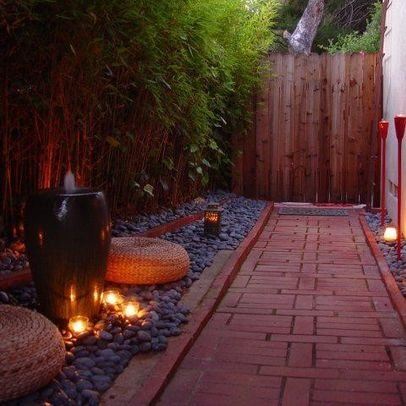 "by Nancy ""Brick walkway. LOVE the rock/pebble garden and the lights/torches, and even the bamboo (though Id be scared to actually plant bamboo - though we could probably make it work in a pot or box)."""