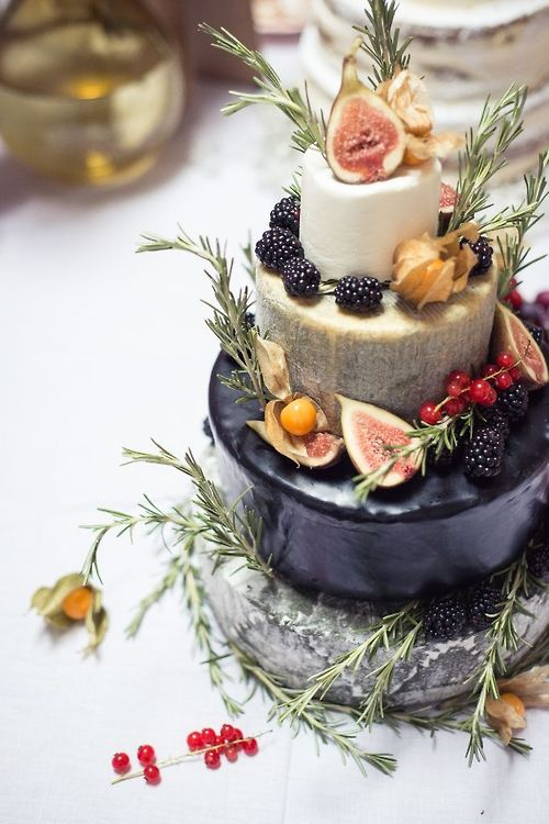 A tiered cake of cheese with fruit. Lovely.(Cheese Table Setting)