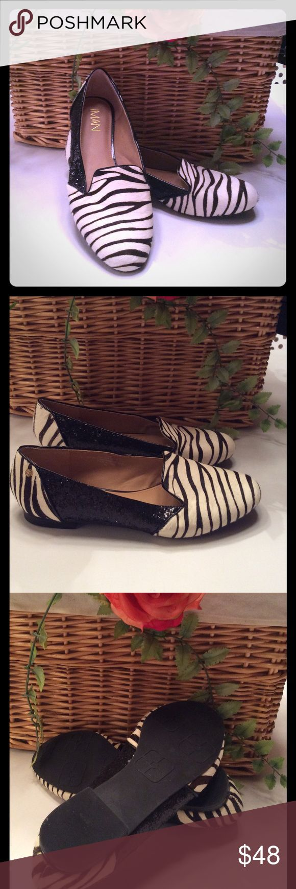 IMAN BLACK & WHITE ZEBRA AND BLACK SEQUIN SHOE IMAN BLACK & WHITE CALF HAIR ZEBRA AND BLACK SEQUIN SHOE. GORGEOUS AND ONLY WORN ONCE. THE SHOE IS A 9W AND IS IN EXCELLENT CONDITION. FROM HSN. Iman Shoes Flats & Loafers