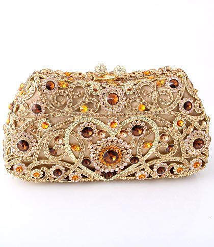 This clutch bag is from our high end exclusive range, embellished with over 120 swarovski crystals with a lot of detail and high quality material used supported by a hard case body. This is a luxurious and timeless clutch bag that is created meticulously and flawlessly. This bag is a tribute to the hours spent in its creation. It is more of an artwork or a piece of jewellery than a handbag! Buy this from Deeya at www.deeya.co.uk or pin it if you like it.