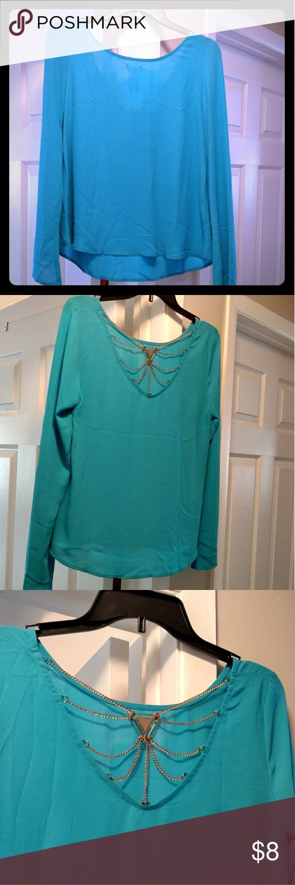 Beautiful teal blouse with chain detail on back Worn once size large beautiful flow teal blouse . Perfect condition mine Tops