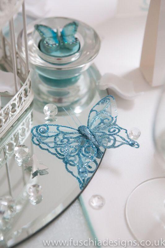 Spearmint butterfly accessories glitter wire butterflies and butterfly Tea lights. Look pretty on a glass mirror with diamonds. www.fuschiadesigns.co.uk