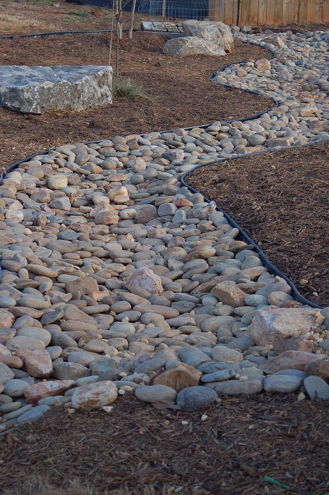 how to build a drainage ditch with river rock
