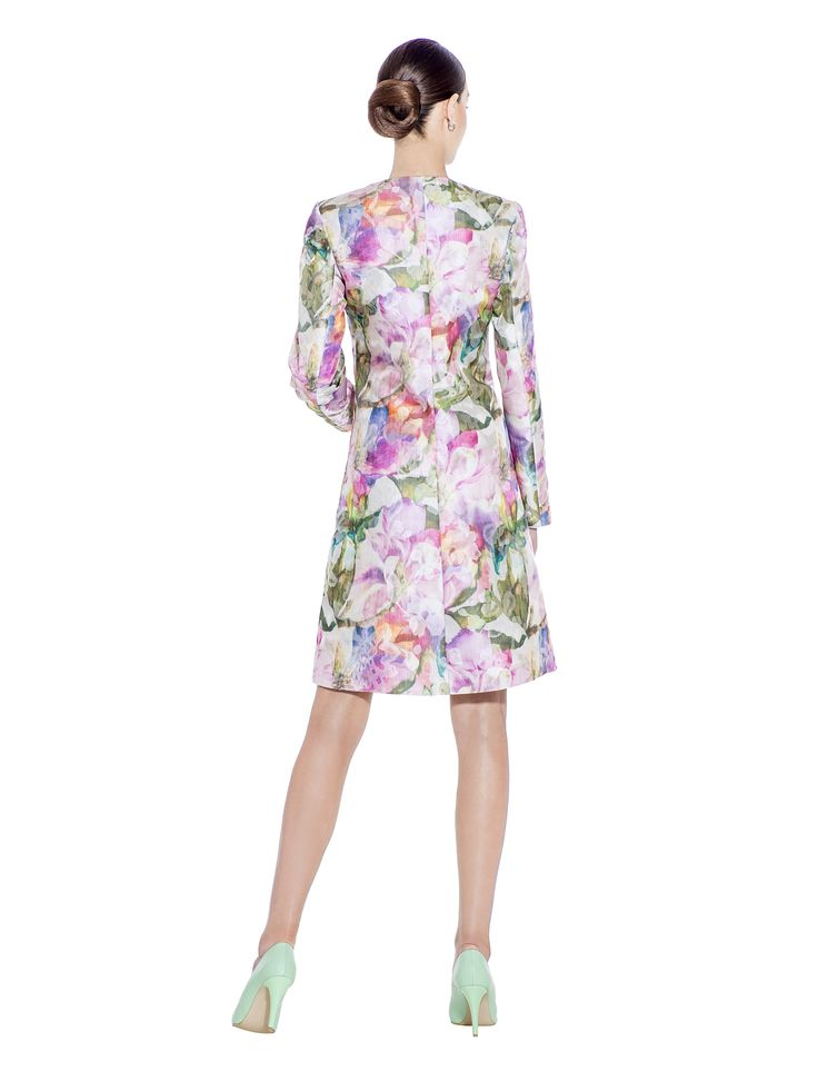 Keep your style looking sleek with this floral coat in contrasting textures. The bold patterned light taffeta material with long slim sleeves and 'A' shape, gives a subtle sheen that's perfect for any cocktail hour. This coat makes the perfect companion to the matching taffeta floral skirt. Fabric imported from France: 100% Polyester / Taffeta Lining imported from Germany: 100% Viscose Washcare: Dry clean MADE IN EUROPE