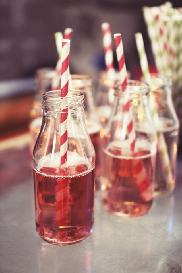Set a fun and informa element at your wedding with {Striped straws and glass bottles.} as welcome drinks