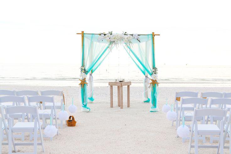 Tiffany blue and white beach wedding arbor. www.tidetheknotbeachweddings.com