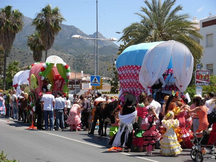 SAN ISIDRO Fiesta in Nerja town next to La Herradura, Spain. Every year in May is this Fiesta with a colourful procession from the town to the Caves.  One of the best festivals of the year. Vibrant, colorful & great fun. It usually heralds the start of good weather for the summer. San Isidro is Nerja's patron saint, and story goes that although he was a peasant agricultural worker his generosity was legendary. During the day you can eat drink, dance & be happy…