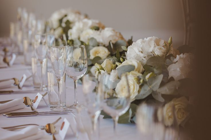 Top Table Decoration of white Hydrangea, ivory Roses and ivory Lisianthus with pastel Eucalyptus foliage at Froyle Park by Fiona Curry Flowers. Picture Motiejus