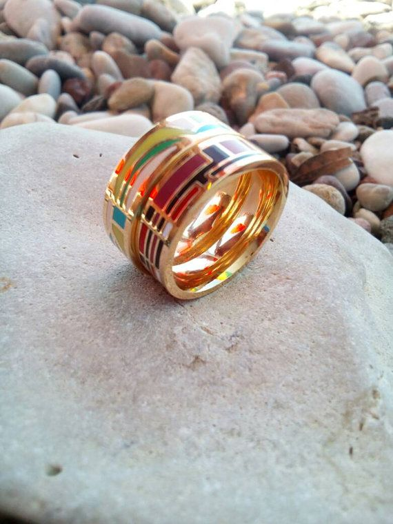 Check out this item in my Etsy shop https://www.etsy.com/listing/473389985/stainless-steel-statement-rings