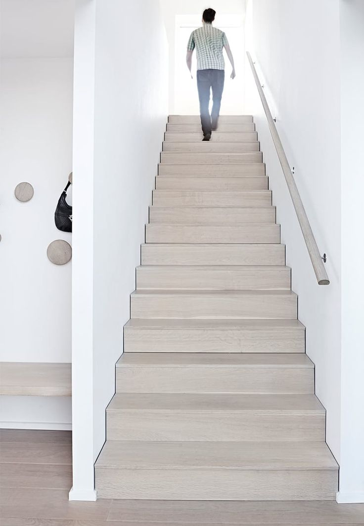 Beautiful stairs in light wood, keeps the room bright and calm.