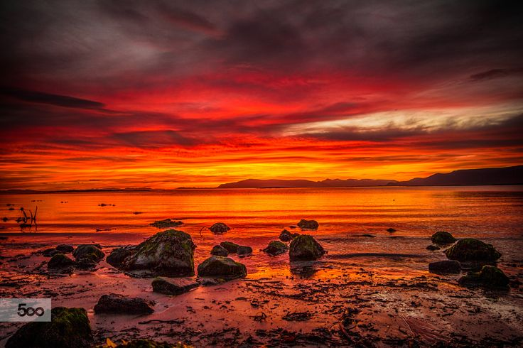 We have had an amazing midnight sun here in Reykjavik over the last evenings/nights. Around 02:00 AM last Saturday night I went to the seashore close to my home and captured these stunning colors.