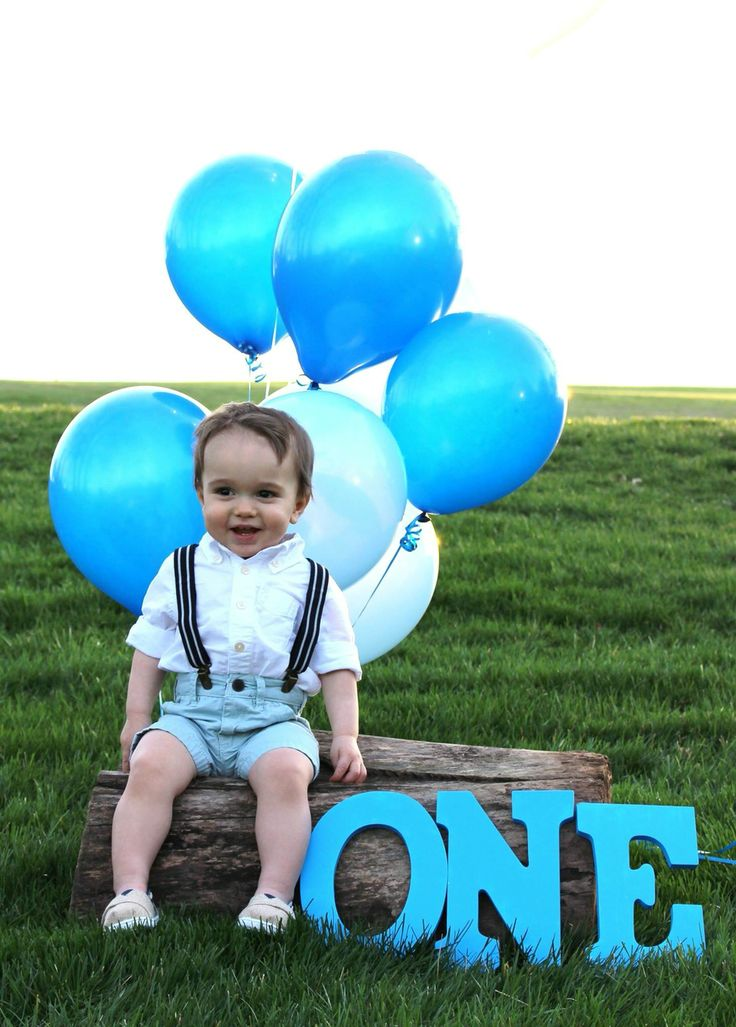 First birthday boy photo shoot suspenders letters balloons