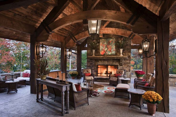 Rustic outdoor living. Stone fireplace. Arches & beams. Covered. mountain-homes-locati-architects-06-1-kindesign