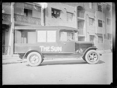 Sun newspaper truck on Dowling St garage in eastern Sydney (year unknown). •Fairfax Archives•