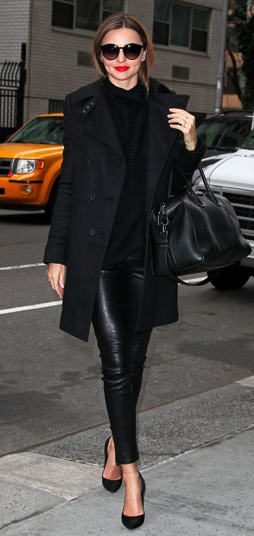 Miranda Kerrs effortless look in a classic black trench coat, Givenchy bag, round oversize sunglasses, skinny leather trousers and pumps with a pop of red lips