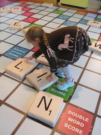 What an interactive process! Learning through a giant Scrabble game at the Mississippi Children's Museum.