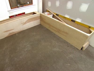 There is a great DIY vid here of this guy making banquette seating with lift-up storage... easy-schmeasy!
