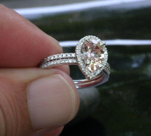 Pear halo morganite ring. I want a pear wedding ring so bad!
