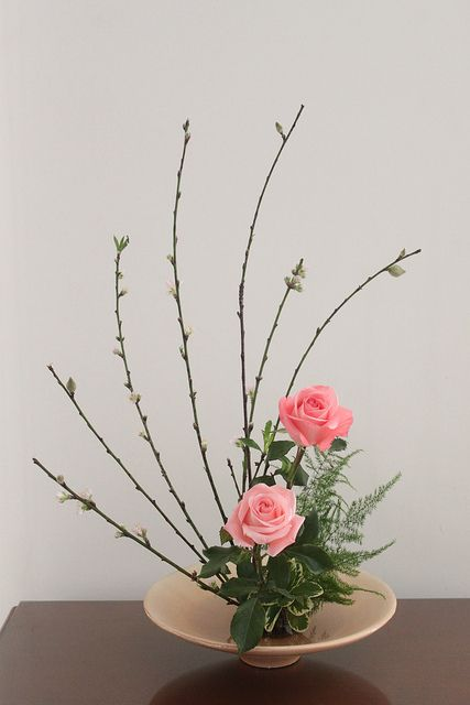 "Moribana. Moribana upright style  is considered as the most basic structure in ikebana. Moribana literally means ""piled-up flowers"" that are arranged in a shallow vase or suiban, compote, or basket. Moribana is secured on kenzan or needlepoint holders, also known as metal frogs."