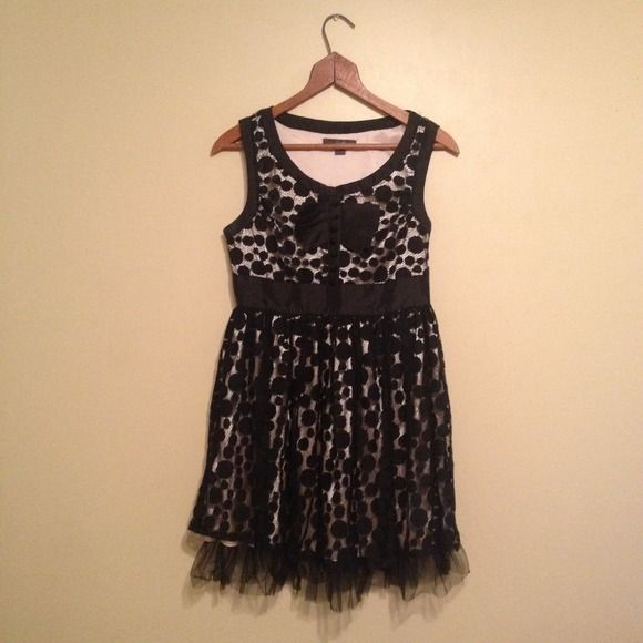 Black and nude party dress Fabulous dress for special occasions! Black lace with dots over a nude shell. Ruffle and button details at the top. Tulle around the bottom hem. Excellent condition. Dresses