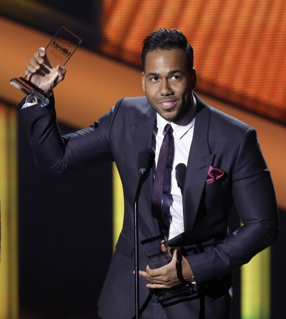Romero Santos of Aventura accepts his Billboard Latino Award