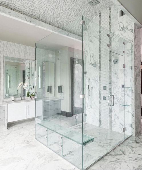 All glass shower and stunning marble