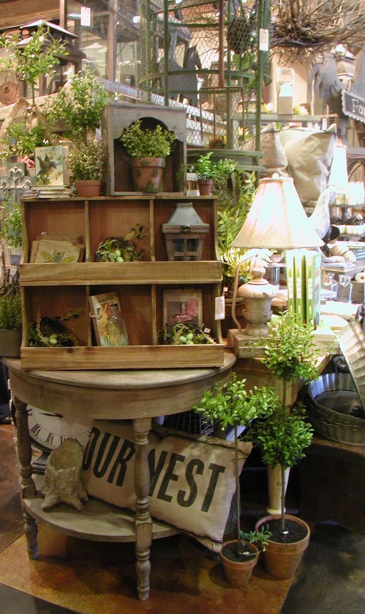 "The Farmer's Wife - a rustic farmhouse and garden accessories shop in Old Town Temecula, California.  Great example of ""building"" a display. #merchandising"