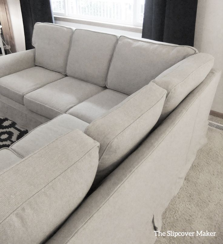 I used rustic a linen and cotton blend in undyed color Oatmeal to create a casual slipcover for this sectional sofa. Fabric: Upholstery Linen from Gray Line Linen.
