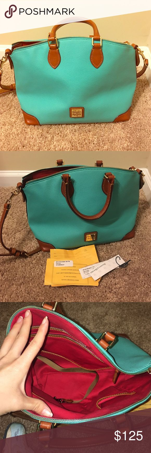 """Dooney and Bourke Seafoam Handbag😍 Literally a brand new purse. This is a pretty big purse, tried to capture size as best a possible. I'd say about 8"""" tall 12""""wide. Beautiful classic red inside. I bought this for myself and my mom bought me the exact one for Christmas. All tags and registration number included! Bags Shoulder Bags"""