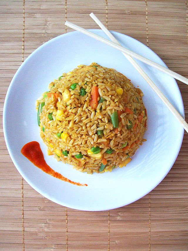 This Spicy Vegan Fried Rice gets its hot flavor from curry powder, black pepper, and Sriracha sauce!