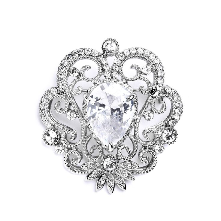 """With its mix of modern bling, vintage filigree style & fiery Cubic Zirconia, this 1 3/4"""" h x 1 1/2 fashion brooch is sure to turn heads during any wedding."""