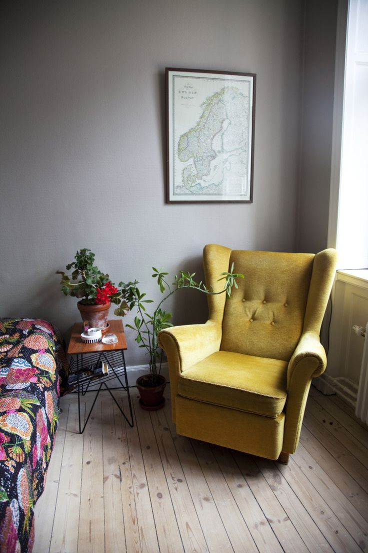 Mustard velvet armchair, pale floorboards, grey walls and a gorgeous kantha quilt to finish... perfect...