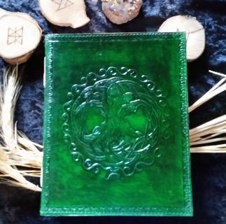 """Handmade leather bound blank book with fabric parchment, ribbon book mark, and lined cover. You will not find quality like this anywhere else. Wonderful for your journal, sketch pad, Book of Shadows, or whatever you might want to use it for.  9"""" x 7"""" Approx 280 pages Limit stock - only ordered twice a year.  Order now before they run out."""