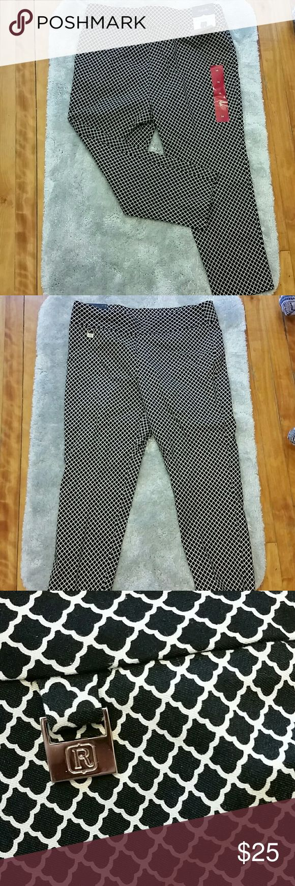 NWT Rafaella Capri Size 14 Rafaella comfort capri is guaranteed to fit your shape and move with your body. It has a expandable waistband. They are a dark navy blue and has a very pretty design throughout. Wear to the office or a casual dress. Rafaella Pants Capris
