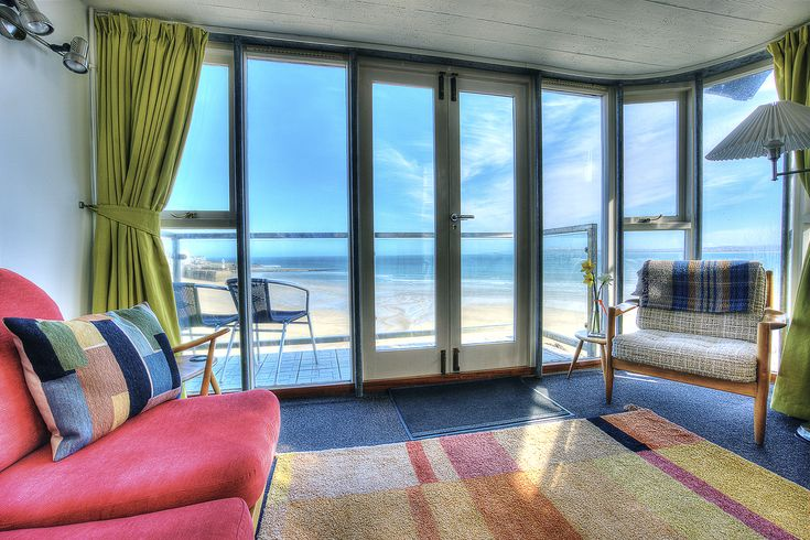 St Ives   with two double bedrooms sleeping four.  Magnificent seaviews towards St Ives Harbour and the surrounding  bays from every floor and from the large balcony.Sleep 4