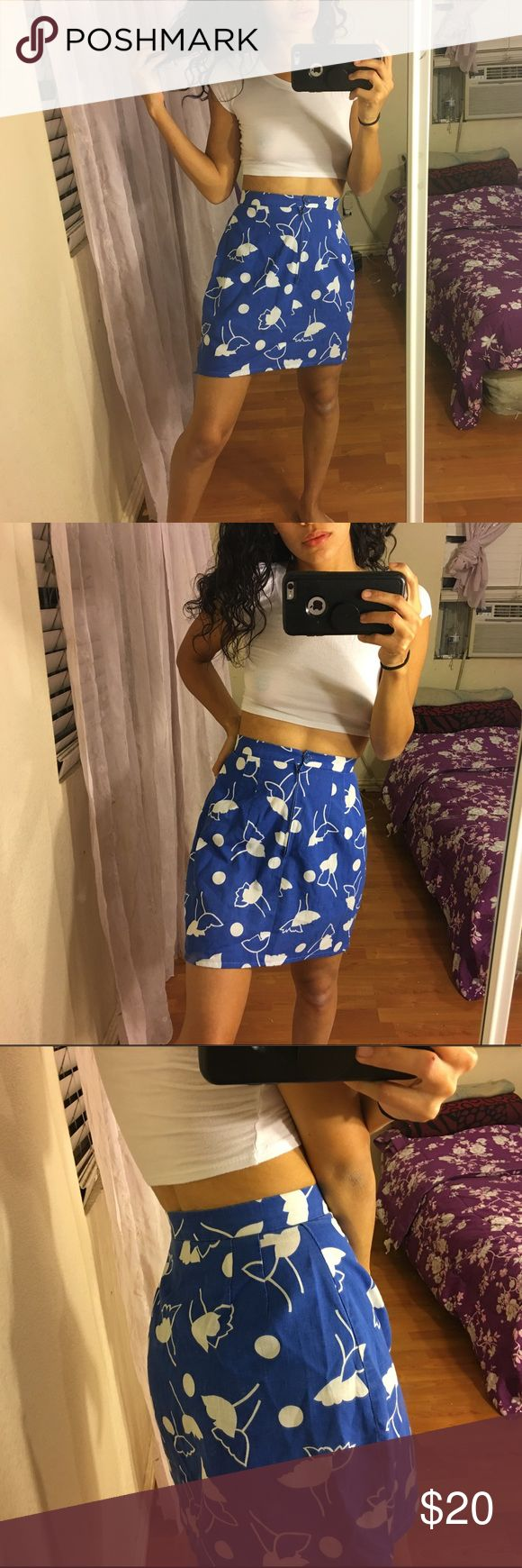 Handmade Blue and White Patterned Skirt high waisted, and so perfect for spring and summer, no tags, best fits XXS-XS approx., model is XS and fit on the waist but on an empty stomach 😫 lol, so I recommend for someone smaller than me. model is 24 in waist and fit just right.   waist: 12 in length: 16 in Skirts Mini