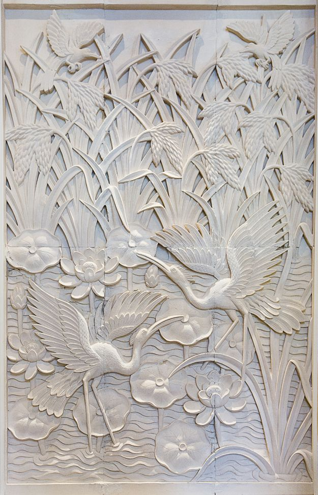 Hand-carved in Bali by artisan Made, this sandstone wall depicts cranes wading in a pond flecked with lotus flowers. On display in The Gir House of #Memphis.