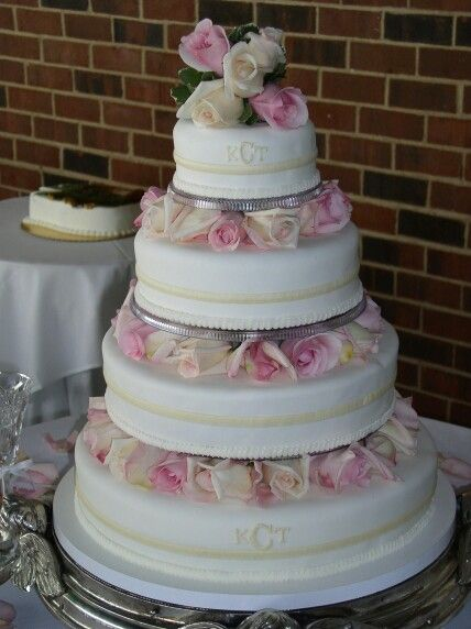wedding cakes with pillars and roses to make a wedding cake look larger add pillars with 26080