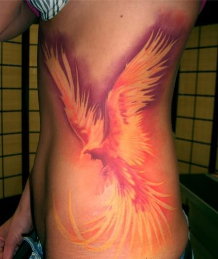 I've identified with the phoenix for a long time and would like to get one possibly on my back but most of the ones I see either look like angry chickens on fire or peacocks with longer feathers. I like the coloring of thus one.