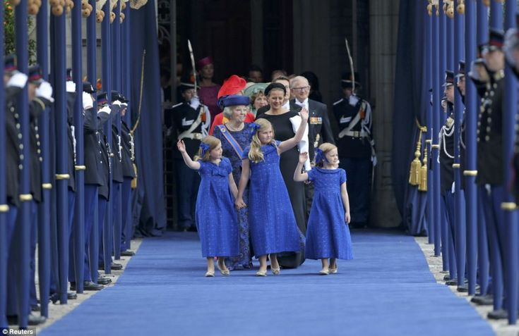 Little princesses: Alexia, seven, Catharina-Amalia, the nine year old heir apparent to the throne and their little sister Ariane, six, dressed in blue wave to the crowds