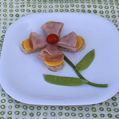 Learn how to make fun foods for kids like this flower snack!