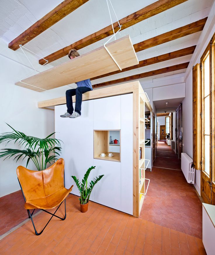 Desk hangs from ceiling of Barcelona apartment by Anna and Eugeni Bach