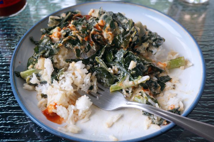 Soft, tender collard greens, braised in a flavorful sauce of coconut milk and peanut butter, served over warm white rice. If that doesn't excite you, I'm not sure we speak the same culi…